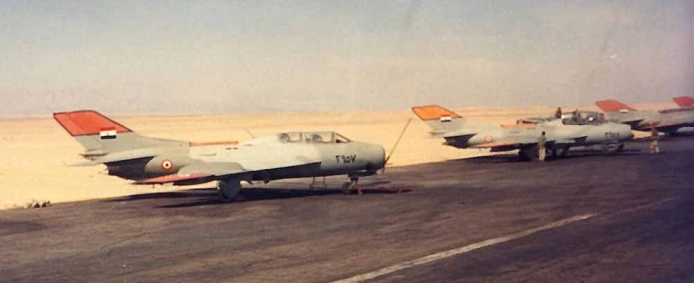 EAF Shenyang FT-6 in the nineties. It displays black-edged yellow identification panels on its tail-fin, fuselage spine and wingtips.