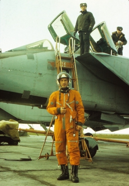 Soviet 72nd Guard Fighter Air Regiment PVO's pilot in front of their large MiG-31 'Foxhound' fighter aircraft at the Amderma airport in the early nineties.